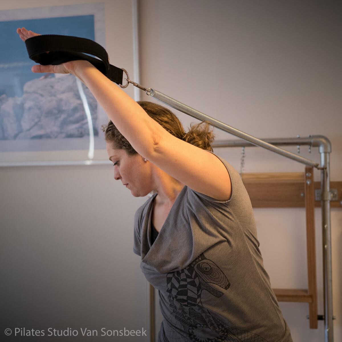 Butterfly met Arm Springs van Wall Tower (Pilates Studio Van Sonsbeek)